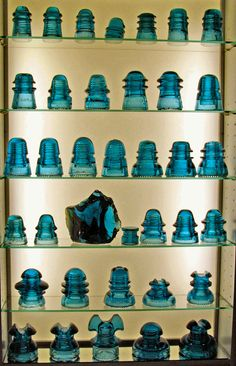 Collection of blue antique glass insulators.