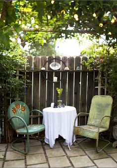 Private corner. Love the odd chairs and the hanging light... I want to sit there, having lemonade on a warm summer day... Image from http://www.desiretoinspire.net/blog/2011/3/18/light-and-bright.html