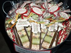 """Hershey Nugget Trays: These were my best sellers! I made some Thanksgiving-themed ones, along with Christmas-themed. I wish I had made more. They were pretty simple. I wrapped Hershey Nuggets (bought in bulk) and then made a """"tray"""" from cardstock and put them in a pretzel bag. I made a tag for each of them and then tied with ribbon. I had seen these from a friend of mine and thought they were adorable!"""
