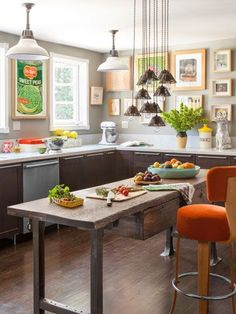 Great Pops of color in the artwork on the walls of this kitchen.  So fresh and fun!