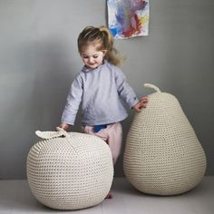 James' Giant Apple Pouffe These robust apple and pear pouffes are made from organic crocheted cotton and make a wonderful edition to any nursery or playroom!