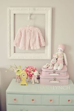 Frame a special piece of baby clothing by hanging an empty frame around a hook. That way, your new baby can still wear the item when you want. It will make a lovely display in your baby's room!