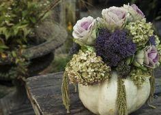 Fall Flower Arrangements..Love the idea of using pumpkins to create flower arrangements..