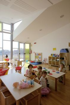 Kindergarten Barbapapa in Italy features a varied roof and furniture/storage modules scaled to the child.