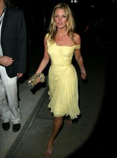 Kate Moss wearing a yellow chiffon micropleated vintage dress by Gres designed by Lloyd Klein 1994