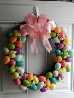 a wreath + a bag of plastic eggs + a hot glue gun + a ribbon (to make the bow)  +  a Sunday afternoon = Easter Wreath