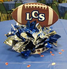 Possible idea for football dinner centerpiece...cut football with cricut, use tissue paper in LVHS colors, spray paint foam circle for base?  Can have pictures coming out of the base (floral picks, maybe?)
