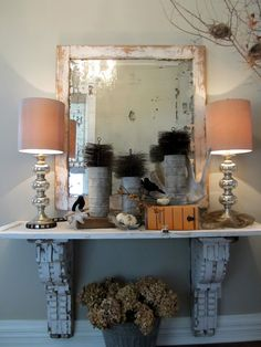 Shabby Chic Entryway Table...made from two old chippy corbels and a cabinet door...from Ella Elaine.