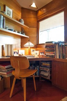 Tucked into the corner of the room, a Thonet plywood chair and a built-in desk make valuable use of an otherwise tricky corner. The Dobkins House by Frank Lloyd Wright.