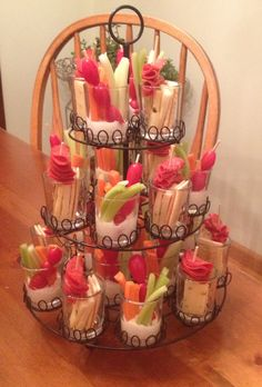 Break out your cupcake stands...they make great individual appetizer holders. In mine - carrots, celery, cherry tomato's on a toothpick with a squirt of dressing OR Crackers, cheese and some pepperoni on a toothpick. individual appetizers, tomatoe stands, cupcake stands, appetizers on a toothpick, babi shower