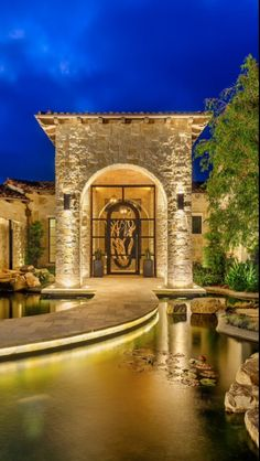 "Luxury home Entry Courtyard, with reflecting pool / koi pond. The walkway serves as a ""bridge"" across the pond..."