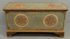 Unusual Pennsylvania German original paint decorated pine blanket chest dated 1830, with pinwheel decoration and straight bracket feet, the back painted with initials SH and date 1830. 25h.x48w.x20.5d.