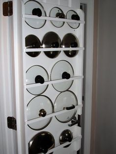 This is just one of the clever Ideas in this kitchen makeover. Love this idea for storing pot covers!.