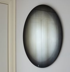 Fading mirror in black. 'fading mirror' consists of a printed gradient placed between the glass and the silver reflective layer. the black and white fades   create a frame for the reflected images.
