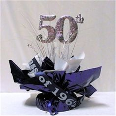 Days Past centerpiece can be ordered in your school colors and features your school's name and graduation year.