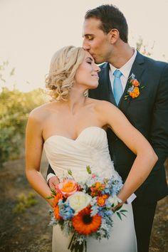 loving this orange and blue color combo // photo by Hom Photography // http://ruffledblog.com/french-country-inspired-wedding