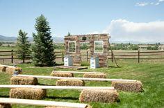 I like how they ahve the wood on top of the hay bales! Colorado Country Barn Wedding: Jamie Brandon