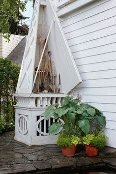Love the idea of creating a decorative obelisk to hide an AC unit and provide storage for larger garden tools, like rakes and hoes!!
