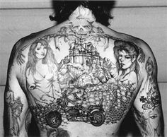 tatted a gilr on your back if you are a biker man