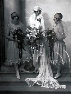 A bride and her attendants, Melbourne, Australia, 1920s. Very interesting diamond details on the skirts of the bridesmaids, plus veils that wrap under the chin as well as over the forehead.