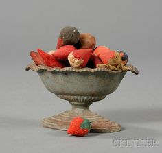 Small Blue-painted Cast Iron Urn Filled with Strawberry-form Pincushions and Emories, America, late 19th/early 20th century