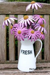 "Michelle Nun's perfect Echinacea Purpurea ""Paperie"".  Clever crafter has created coneflowers with Cricut Giant flowers and even named the variety.  hahahaha  Def want to try these!"