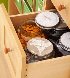Fill a deep desk drawer with containers of snacks (we used clear-glass cracker jars). Label the lids with dry-erase markers on vinyl-coated paper.