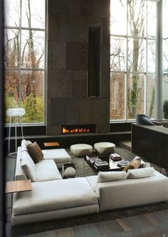 great monolithic look with horizontal linear fireplace and a tall vertical niche clad in natural stone decor, modern fireplaces, modern living rooms, couch, floors, window, high ceilings, design blogs, living room interior design