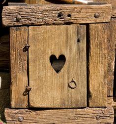 Earthtones...( shades of brown )---A small heart door.
