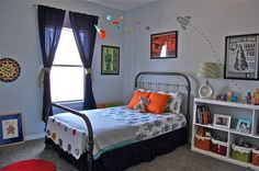 Space-themed room...Amy, I like the space jet with dashed line behind it.  We can do this across his room.
