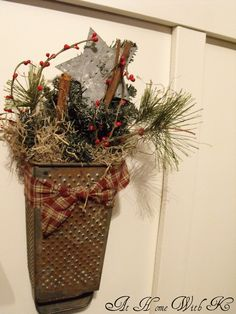 cheese grater turned upside down and filled with Christmas items, tied with a gingham bow