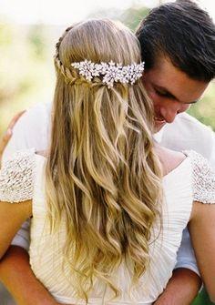 Bride's ornate jeweled barrette with pull back braid wedding hair