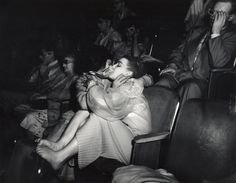 """Lovers"" by Weegee.     with 3-D glasses at the Palace Theatre (Infra-red), 1943."