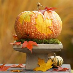 Decorate your doorstep with this sophisticated fall pumpkin. More fall decorating: http://www.bhg.com/halloween/outdoor-decorations/fall-outdoor-decorating-from-halloween-to-thanksgiving/?socsrc=bhgpin101413mapleleafpumpkin&page=9