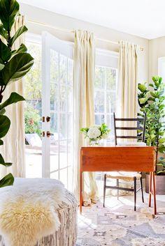 Tour Catt Sadler's Enviable Closet Suite via @domainehome // vanity, curtains, ottoman, sheepskin