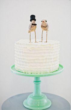 bird cake topper, see more here http://www.weddingchicks.com/2013/08/29/cake-toppers/
