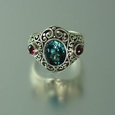 silver ring with London Blue Topaz and by WingedLion