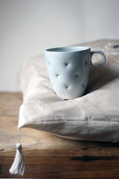 Hand thrown ceramic cup,  hand decorated with pillow effect.