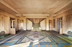 abandoned hospital with beautiful floor and stairway...what a shame.