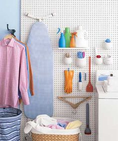 Pegboards to organize a laundry room.
