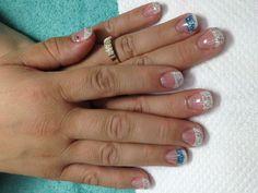 Fun rainbow glitter French gel nails