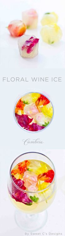 create beautiful chardonnay ice cubes wt edible flowers / garden party perfect / gorgeous + keeps wine chilled with out diluting.  DIY