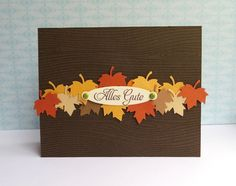 handmade Thanksgiving card ... clean and simple lines ... dark brown base ... small leaf punches in  rusty orange, golden brown and kraft ... like the look of a pile of autumn leaves ...