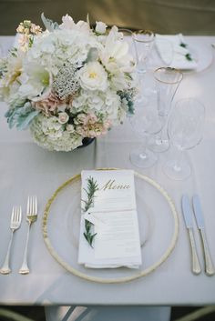 Place Setting with Menu & Gold Rimmed Glass Charger -- See the wedding here:  http://www.StyleMePretty.com/2014/04/17/pastel-colored-holman-ranch-affair/ - Bouquet by FloralTheory.com