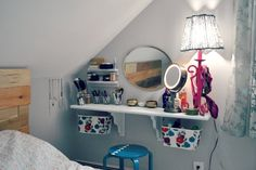 Cute, clean and simple make up area, made from an oak bard, wooden brackets, and baskets hung underneath on ropes. small tables, floating shelves, diy desk, makeup vanities, attic bedrooms, guest bedrooms, small space, diy makeup, girl rooms