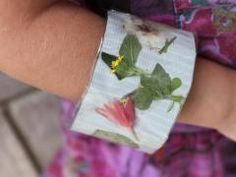 Use duct tape and contact paper to make nature walk mementos into a keepsake bracelet.