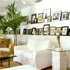 Create a Family Gallery, use one wall to display photos on a shelf east to change up the pictures no hanging issues!
