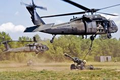UH-60 Black Hawk helicopters airlift 105-mm howitzers to a predetermined area on Fort Drum, N.Y., July 18, 2012. The Soldiers are assigned to 1st Battalion, 258th Field Artillery. The helicopter crew is assigned to Army Aviation Support Facility 3, in Latham, N.Y.