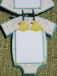 Onesie Mini album.  Baby mini album. I could totally do this with my cricut!