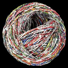 Recycled newspapers made into balls of yarn by Ivano Vitali